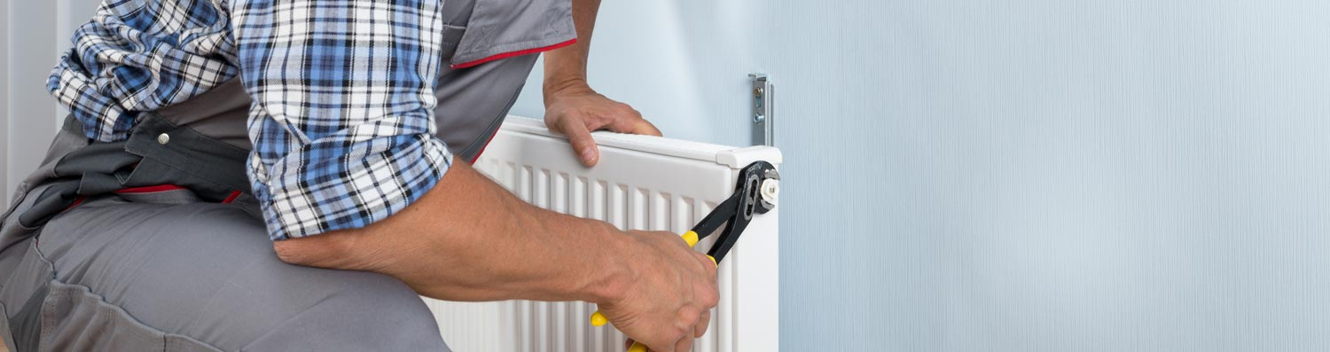 Man fixing radiator
